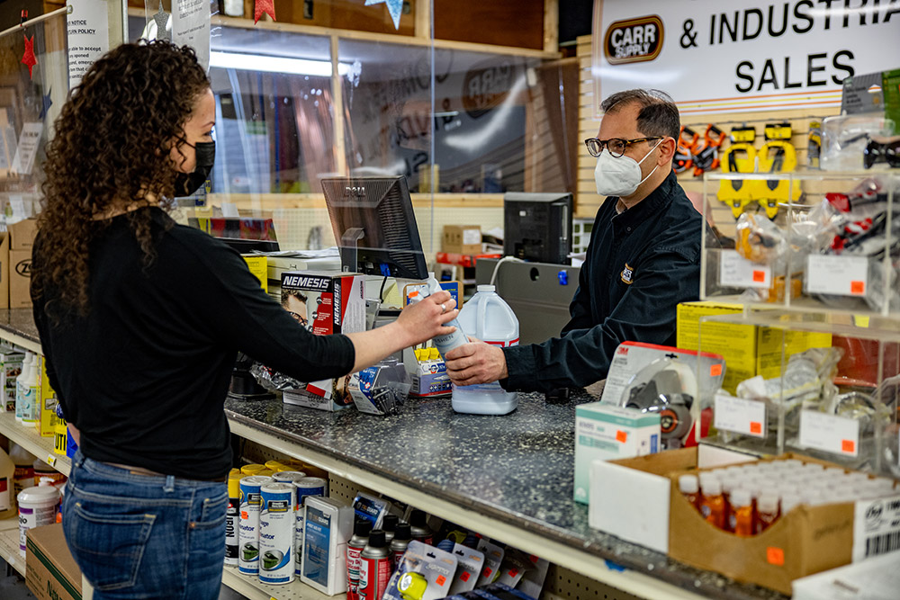 Bart Raser, shown here with a customer, learned the value of giving back to the community from his father, Marshall, who bought the business in 1962.