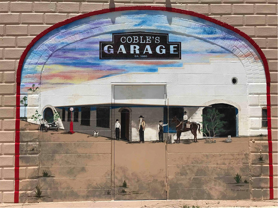 A mural was recently painted on the store's front side that depicts Coble's Garage, a Model T dealership that was housed in the 1914 building.