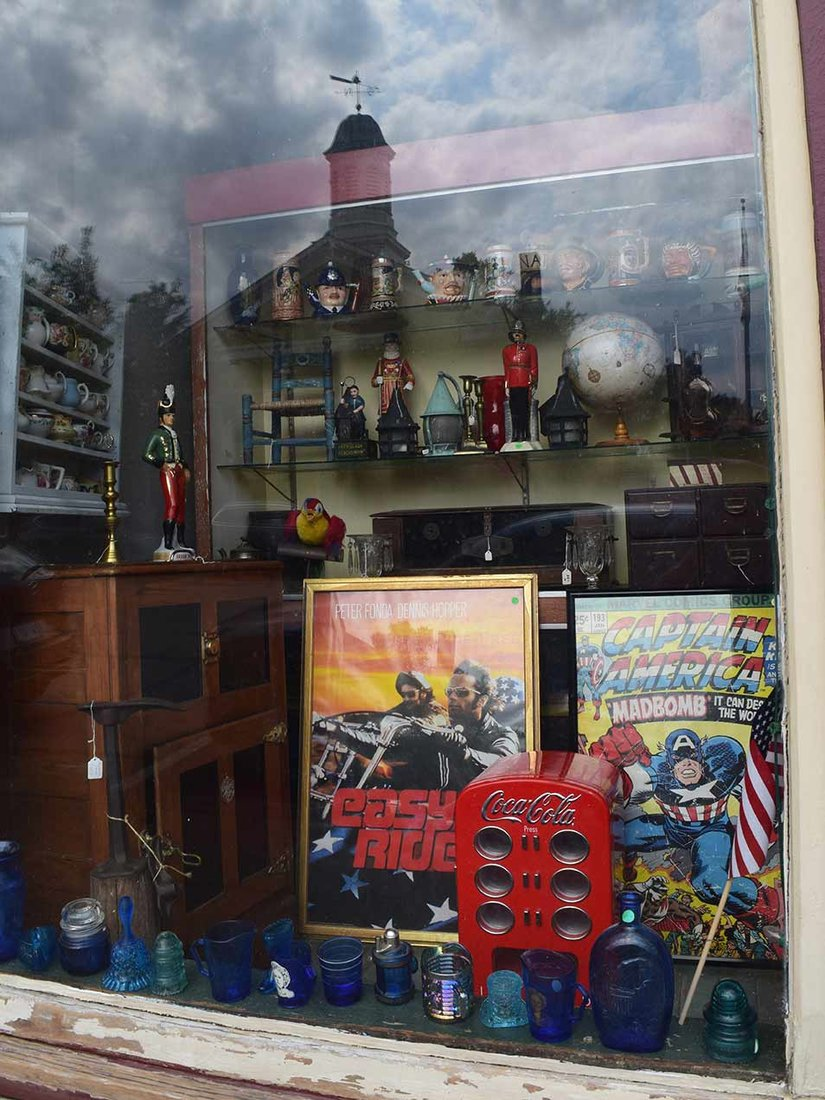 An eclectic mix of antiques and oddities can be found in the store's window displays.