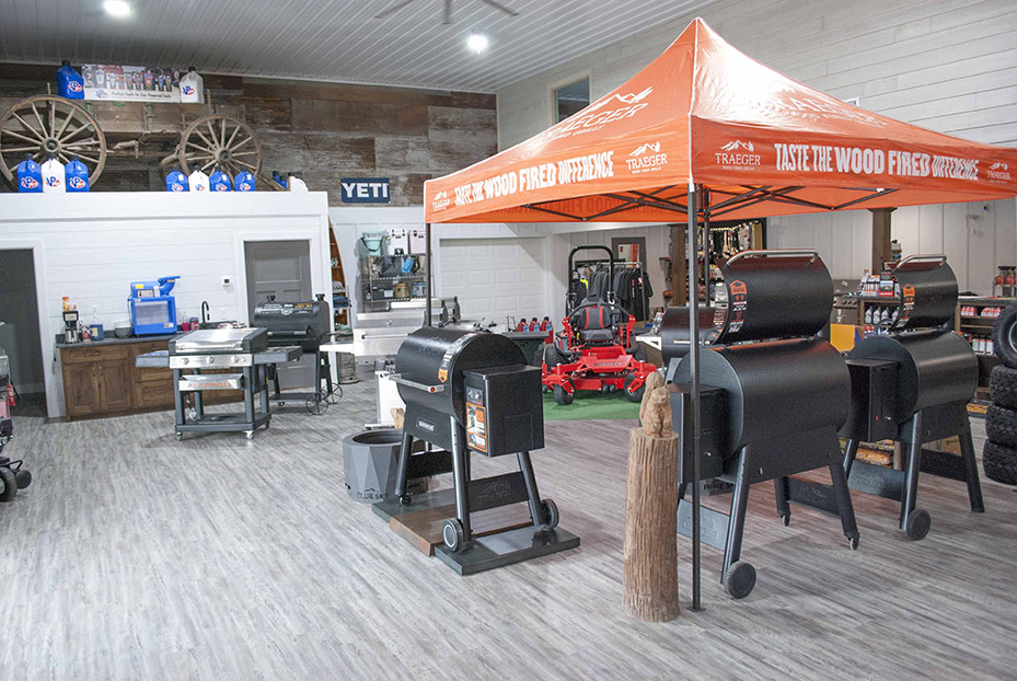 An antique wooden farm wagon is used to display products in the new showroom for outdoor power equipment, grills and rental.