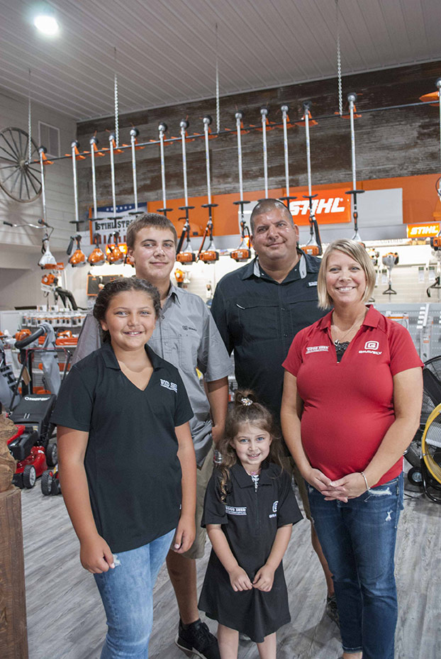Cecil and Sharona Eiserer are developing Wood Shed Lumber & Hardware into a strong, sustainable business that can someday be passed on to their kids (from l to r): Cicily, Porter and Novah.